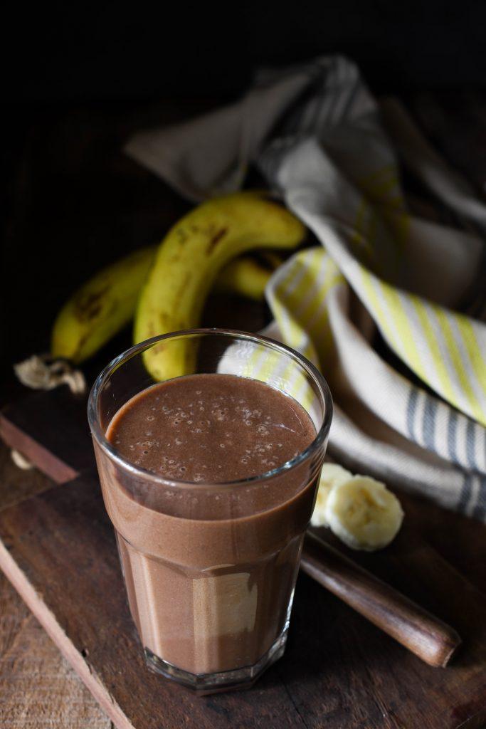 chocolate banana smoothie with sliced banana