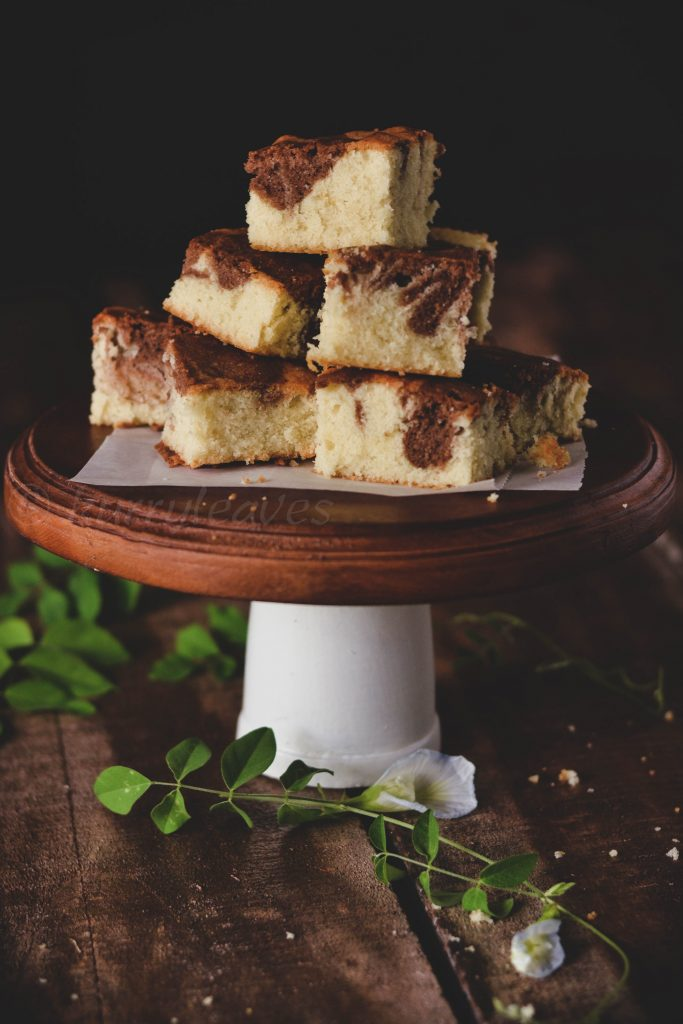 sliced marble cake on a cake stand